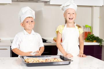 White Little Kids in Chefs Attire Made Pizza