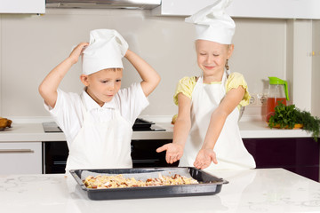 Two Little Chefs Bake Food for Lunch