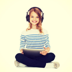 child with headphones and tablet pc