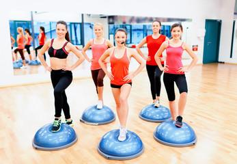 group of female doing aerobics with half ball