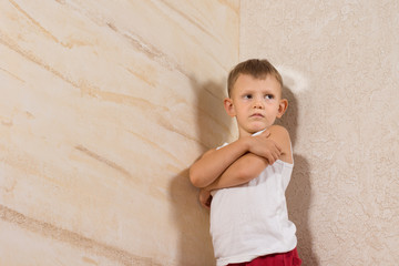 Serious Little Kid Isolated on Wooden Walls