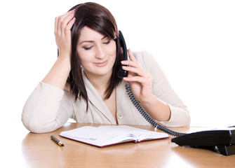 Secretary speaks on the phone during business hours
