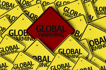Global Warming written on multiple road sign