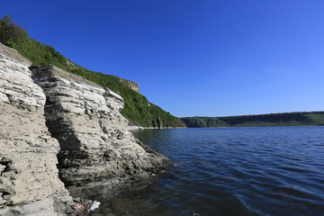 rocky lake shore in nice day