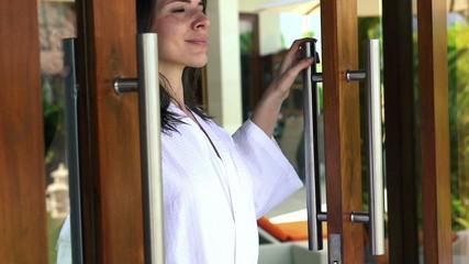 Woman open doors, enjoying beautiful morning, super slow motion