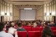 Leinwanddruck Bild - Motion blurred image of classic theater with people