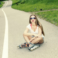 beautiful sexy girl in sunglasses on roller skates