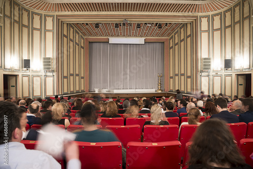 Motion blurred image of classic theater with people - 68696197