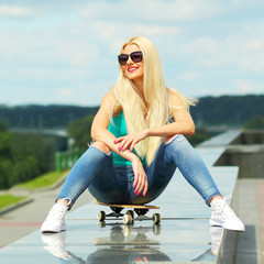 Young active woman  on a skateboard