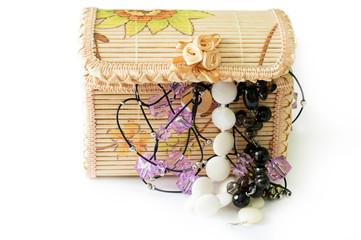 Various women's beautiful jewelry in a wicker box