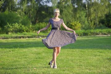 Beautiful woman showing an elegant dress for walk