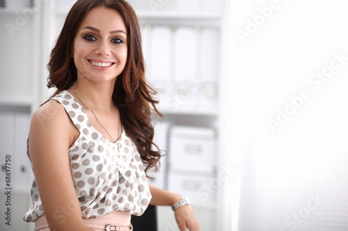 canvas print picture Portrait of business woman standing in office