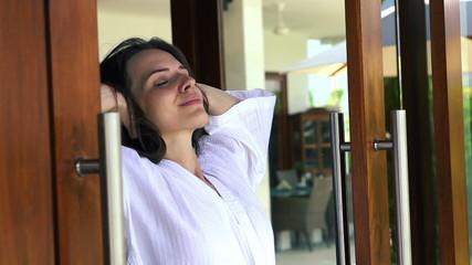 Woman in bathrobe enjoying beautiful day, super slow motion