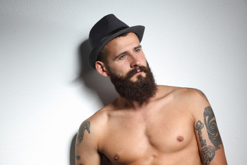 Portrait of handsome bearded man in hat standing , isolated on