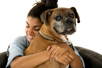cute teenage girl hugging her dog a boxer