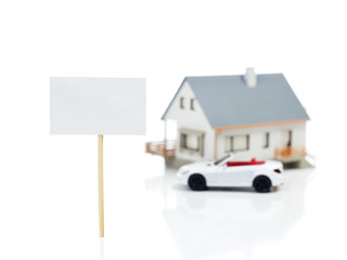 Blank sign and house model and car