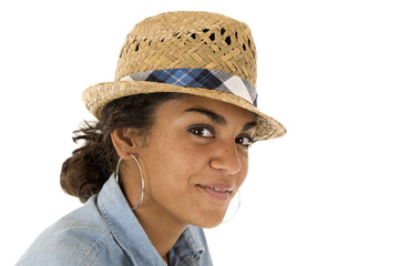 Tan teenage girl wearing a straw woven fedora hat
