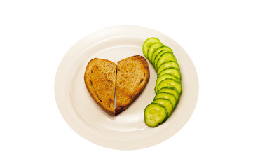 heart-shaped toast and cucumber green