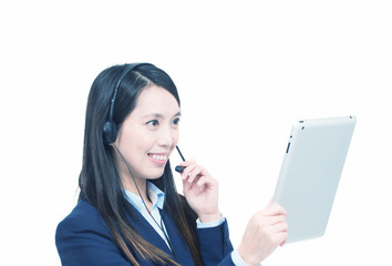 Smiling asian businesswoman working with the tablet speaking at