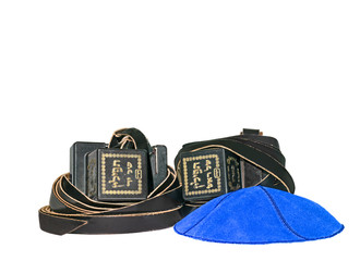 Tefillin and blue suede kippa isolated on white background