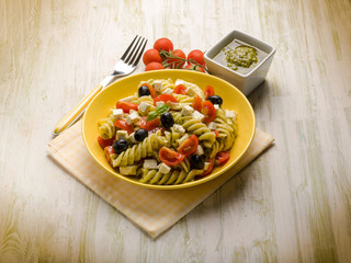 pasta salad with pesto feta tomatoes and black olives