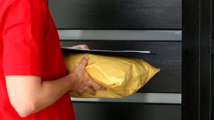 Woman receiving package from delivery man footage