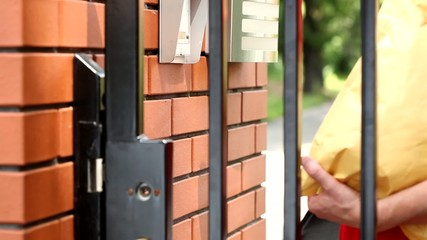Delivery man ringing house intercom footage