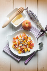 fruit salad with peach almond honey and lavender flower