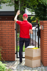 Delivery man delivering packages to home