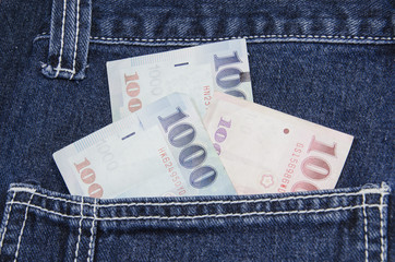 Thai baht notes in jeans pocket