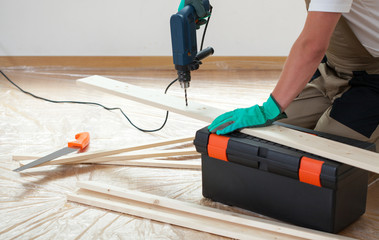 Man using a drill during renovation