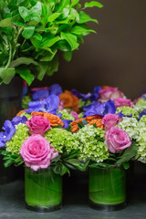 Floral arangement with roses, orchids and hydrangea