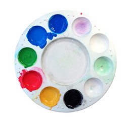 artists palette with various colour paints isolate on white