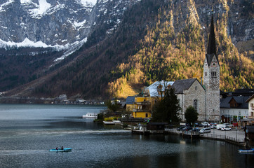 Village with iconic church, lake and mountain background