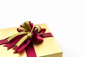 Gold and brown gift box with ribbon bow.