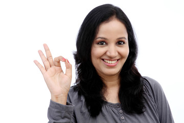 Young woman showing ok gesture