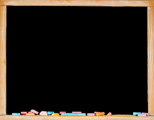 black chalkboard or blackboard and color pencils