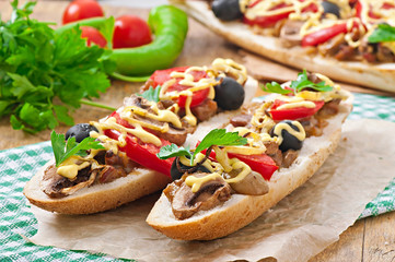 Baguette stuffed with veal and mushrooms with tomatoes