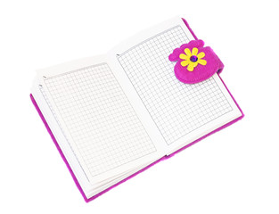 Open notebook in a purple cover on a white background