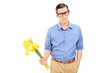 Sad man holding a bunch of flowers