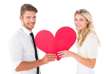 Attractive young couple holding red heart