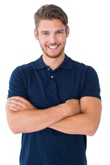Handsome young man smiling with arms crossed