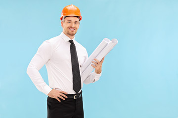 Male architect holding construction plans
