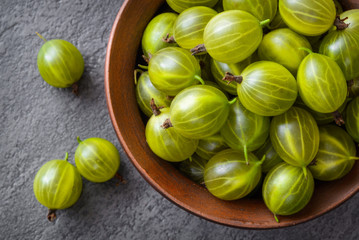 green gooseberries in ceramic bowl
