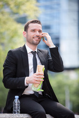 Businessman eating sandwich for lunch break