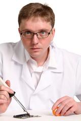 soldering iron in his hand