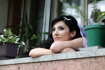 positive thoughtful bride on the terrace