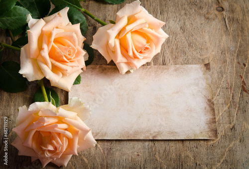 canvas print picture Delicate cream roses on wooden table