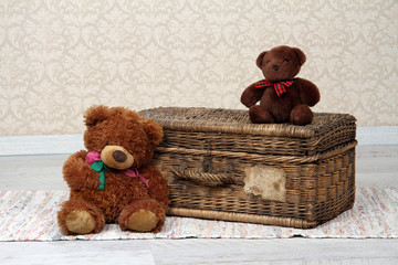 old basket and two teddy bears