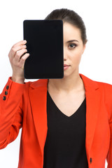 Woman holding up blank tablet computer.